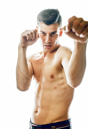 young handsome agressive man boxing isolared on white background 版權商用圖片