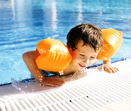 little cute boy in swimming pool Banco de Imagens
