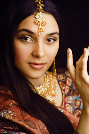 beauty sweet indian girl in sari smiling close up bright jewelry Stock Photo