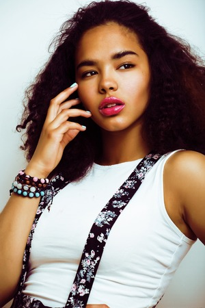 young pretty african american girl emotional posing on white