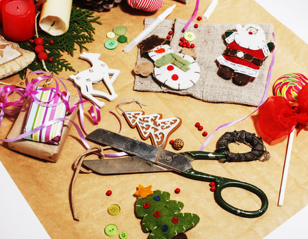 lot of stuff for handmade gifts, scissors, ribbon, paper with co Imagens
