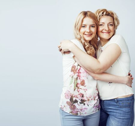 mother with teen daughter together posing happy smiling isolated Banco de Imagens