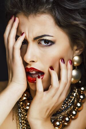 beauty rich brunette woman with a lot of gold jewellery Banco de Imagens