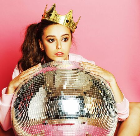 young cute disco girl on pink background with disco ball Imagens