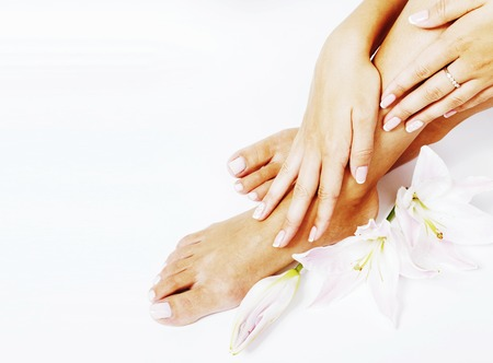 manicure pedicure with flower lily close up isolated on white pe