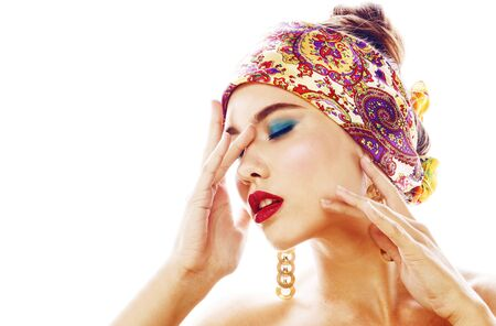 young pretty modern girl with bright shawl on head emotional pos