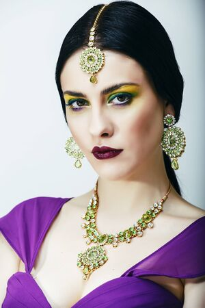 young pretty caucasian woman like indian in ethnic jewelry close