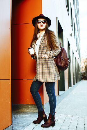 young pretty brunette business woman posing against modern build Stock Photo