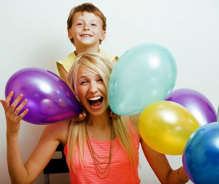 pretty real family with color balloons on white background