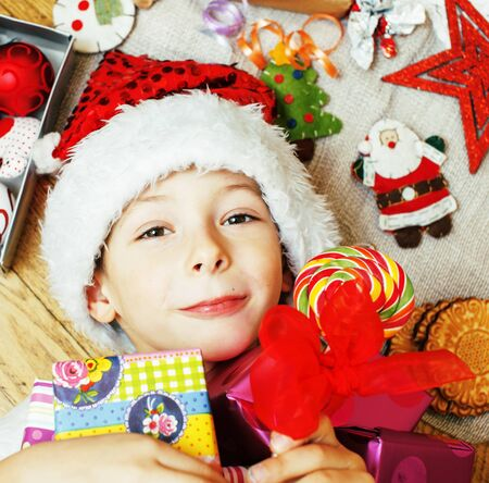 little cute boy with Christmas gifts at home. close up Banco de Imagens