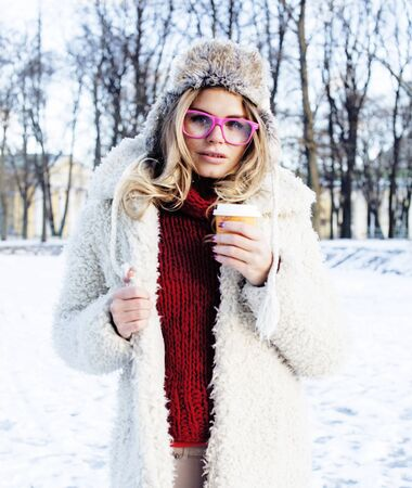 young pretty teenage hipster girl outdoor in winter snow park ha 写真素材