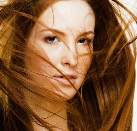 beauty young redhead woman with red flying hair, funny ginger fr