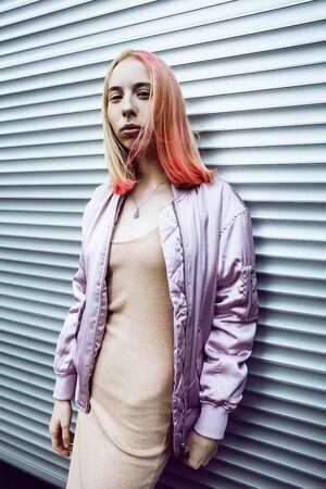 young pretty fashion dressed blong teenage girl posing friendly