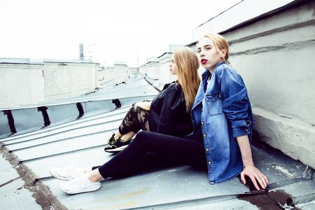 two cool blond real girls friends making selfie on roof top 스톡 콘텐츠