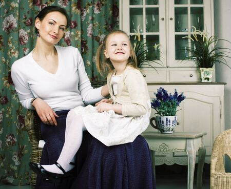 young mother with daughter at luxury home interior vintage Stockfoto