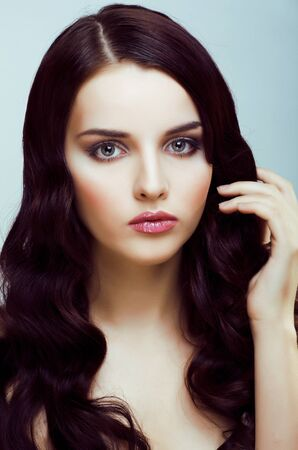 young pretty brunette woman with hairstyle waves
