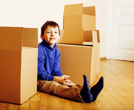 little cute boy in empty room, move to new house. home alone amo Standard-Bild - 129258742