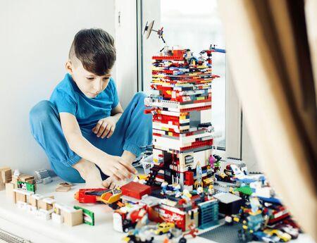 little cute preschooler boy playing constructor toys at home hap Standard-Bild - 129258745