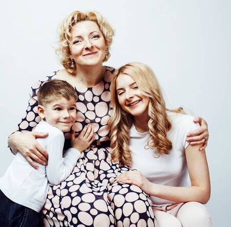 happy smiling blond family together posing cheerful on white background Standard-Bild - 129259111