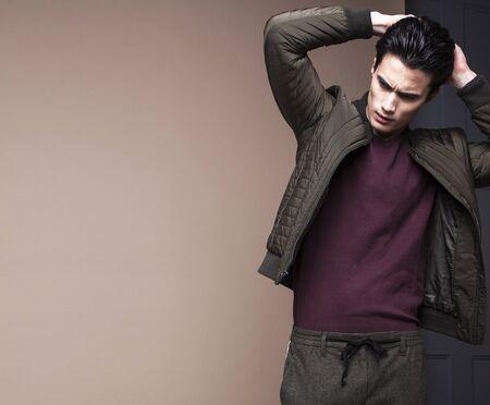 handsome fashion looking asian man posing in studio Stock fotó