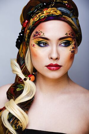 portrait of contemporary noblewoman with face art creative close up