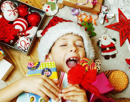 little cute boy with Christmas gifts at home.