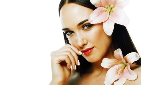 young attractive lady close up with hands on face isolated flower