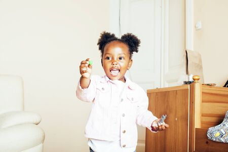 little cute african american girl playing with animal toys at home Banco de Imagens