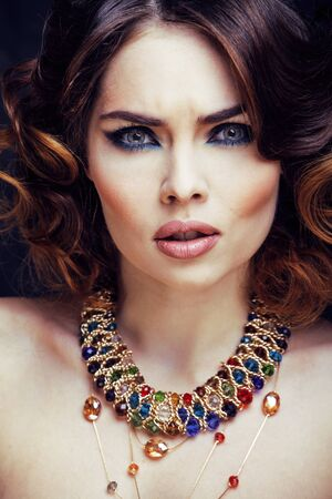beauty rich woman with bright makeup wearing luxury jewellery lo 스톡 콘텐츠
