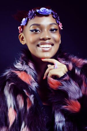 young pretty african american woman in spotted fur coat