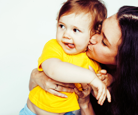 young modern smiling mother with little cute daughter on white b