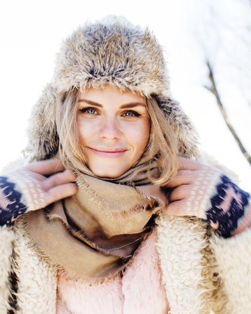 young pretty teenage hipster girl outdoor in winter snow park ha 스톡 콘텐츠