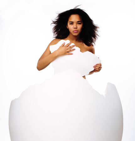 black skined african american young woman in big crashed egg.inception