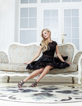 pretty blond woman in rich luxury house interior, fashion people