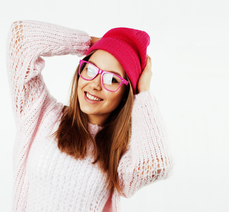 young pretty teenage hipster girl posing emotional happy smiling on white background, lifestyle people concept