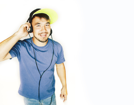 young asian man in hat and headphones listening music on white background 스톡 콘텐츠