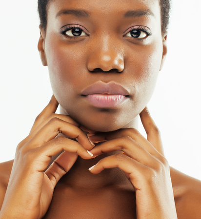 young pretty african american woman naked taking care of her skin isolated on white background