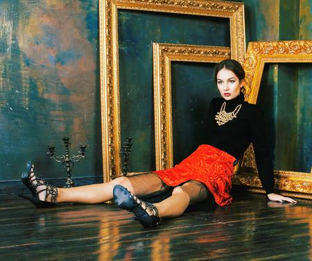 beauty rich brunette woman in luxury interior near empty frames, vintage elegance Banco de Imagens - 119200994