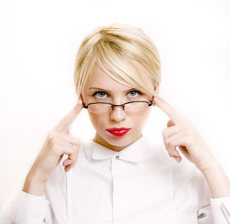 emotional businesswoman in glasses, blond hair on white background. teacher hands up posing isolated. pointing gesturing, lifestyle people concept close up Imagens