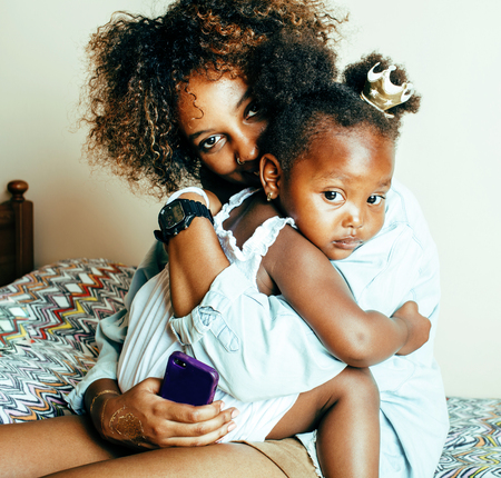 adorable sweet young afro-american mother with cute little girl, lifestyle people concept