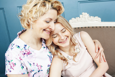 lifestyle people concept: mature blond mother with teenage daughter at home together