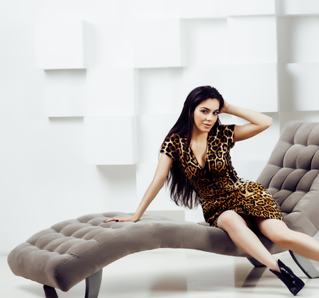 pretty stylish woman in fashion dress with leopard print in luxury house interior, lifestyle people concept Banco de Imagens - 120782484