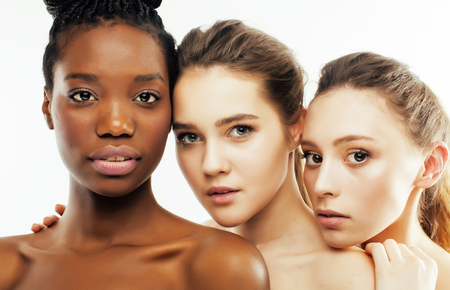 different nation woman: african-american, caucasian, asian together isolated on white background happy smiling, diverse type on skin, lifestyle people concept close up