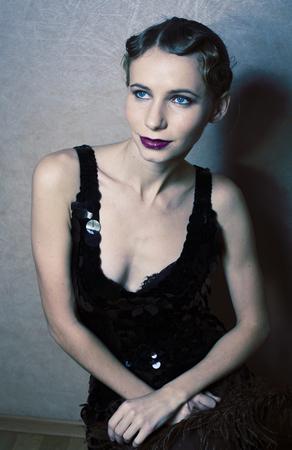 beauty blond woman in studio on black background, stylish fashion retro vintage copyspace close up