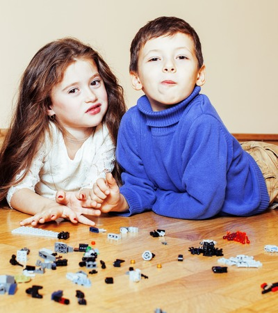 funny cute children playing toys at home, boys and girl smiling, first education role close up, lifestyle people concept Stockfoto