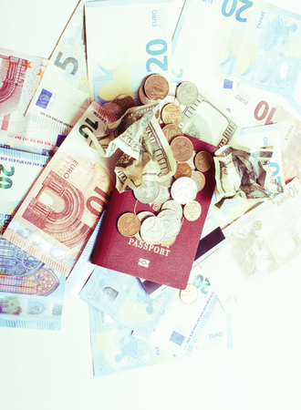 Cash on table isolated: dollars, euro, rubl broken money. All in mess, global crisis . passport travel concept