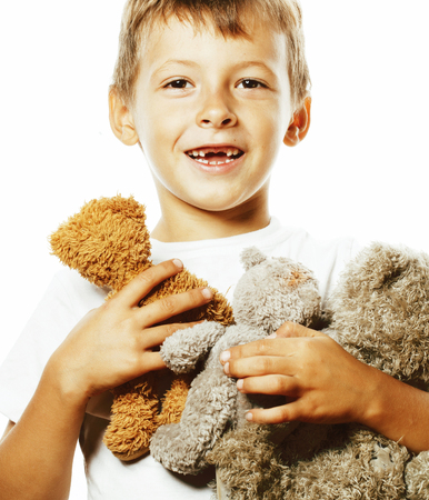 little cute boy with many teddy bears hugging isolated close up