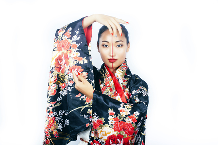 young pretty real geisha in kimono with sakura and decoration on white background isolated