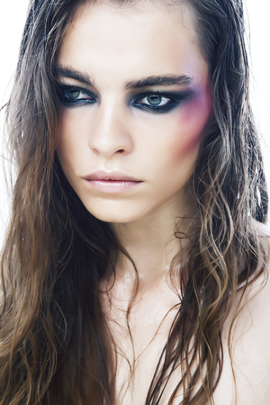 young pretty caucasian girl with fashion style makeup bright colorful eyes isolated on white background, new glamour trends closeup 版權商用圖片