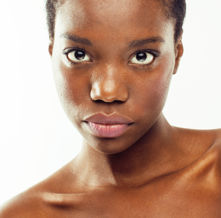 young pretty african american woman taking care of her skin isolated on white background, spa people concept